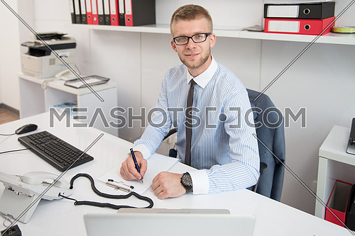 Young Businessman Writing A Letter - Notes Or Correspondence Or Signing A Document Or Agreement