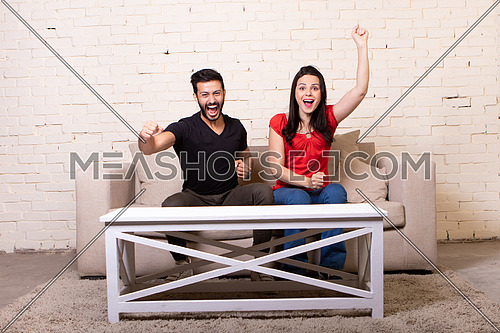 couple sitting on a couch at home