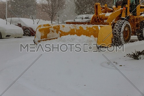 Shnekorotor removing snow on the streets in winter