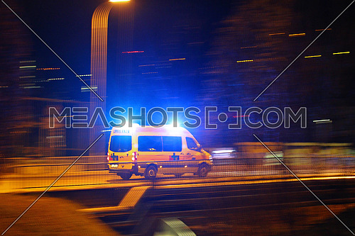 Ambulance motion blur: emergency ambulance service speeding through the night responding to an emergency call