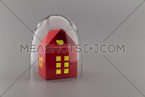Red building with lights in the windows under protective shield as a concept of covid pandemic and self-isolation