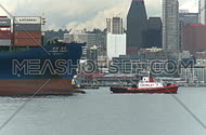 Barge carries freight into harbor (2 of 2)