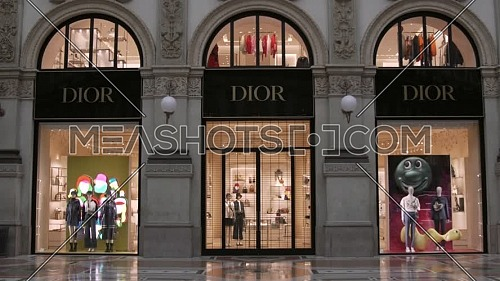 Milan, Italy - June 6, 2021: Dior official shop inside Vittorio Emanuele II gallery, near Duomo Cathedral.
