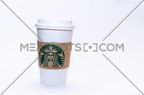 The traditional paper cup Starbucks coffee cup on a white background. December 2018 in Cairo, Egypt
