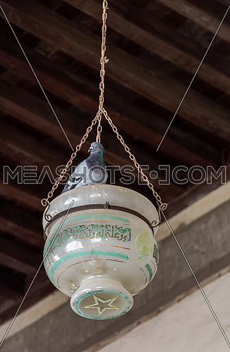 ELHakem Mosque lamp hanging from the wooden ceiling