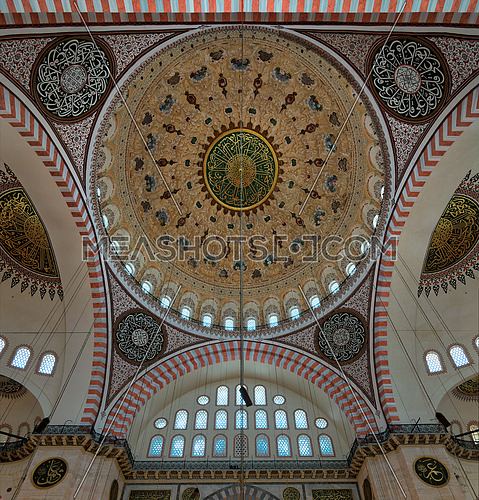 Decorated ceiling of Suleymaniye Mosque with main dome and intersection of three arches, Istanbul, Turkey
