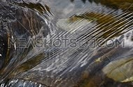 Running ripples on water surface with small rift in day time