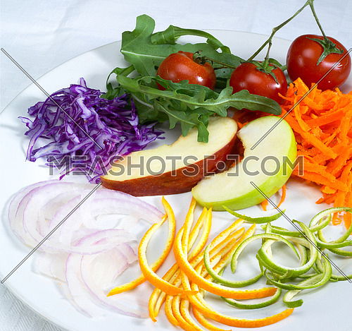 fresh salad ingredient prepared cutted on a plate