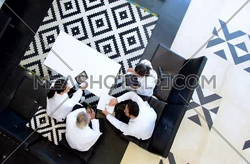 top shot -  middle eastern doctors meeting and discussing x-ray on tablet