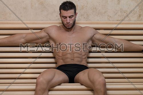 Happy Good Looking And Attractive Young Man With Muscular Body Relaxing In Sauna Hot