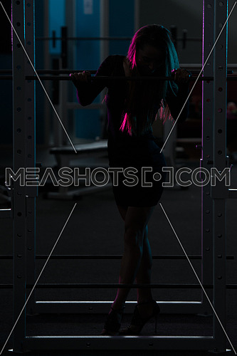 Silhouette Woman Standing Strong In The Gym And Flexing Muscles
