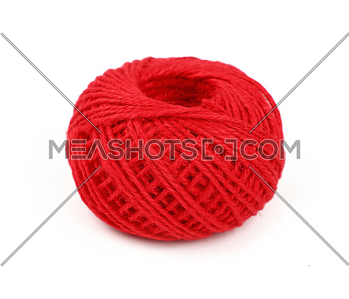 One small round coil bobbin of natural red twine hessian burlap jute rope isolated on white background, close up, high angle view