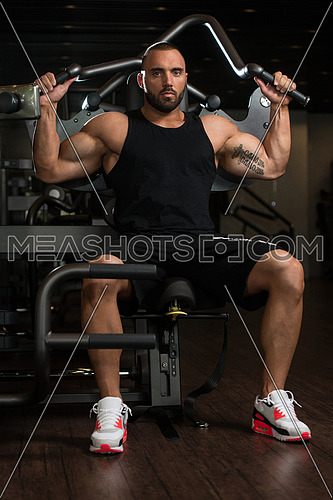 Big Man In The Gym And Exercising Back On Machine - Muscular Athletic Bodybuilder Model Exercise In Fitness Center
