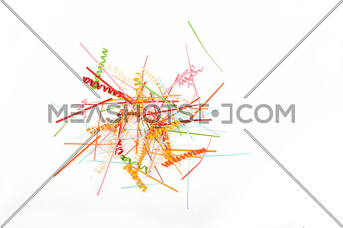Small things matter, spread heap of mixed colorful paper craft pieces decoration elements, stripes and spirals isolated on white background