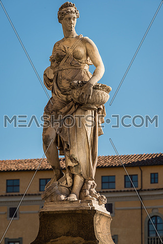 Statue on the bridge of Santa Trinita over the river Arno in Florence, Tuscany, Italy