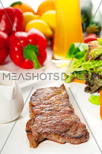 juicy BBQ grilled rib eye ,ribeye steak ,vegetables and lagher beer on background ,MORE DELICIOUS FOOD ON PORTFOLIO