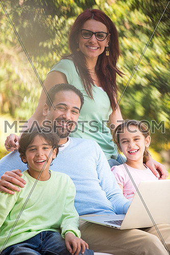 happy middle eastern family enjoying in the garden beautiful summer day