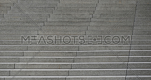 Close up grey concrete stairs perspective ascending, low angle view