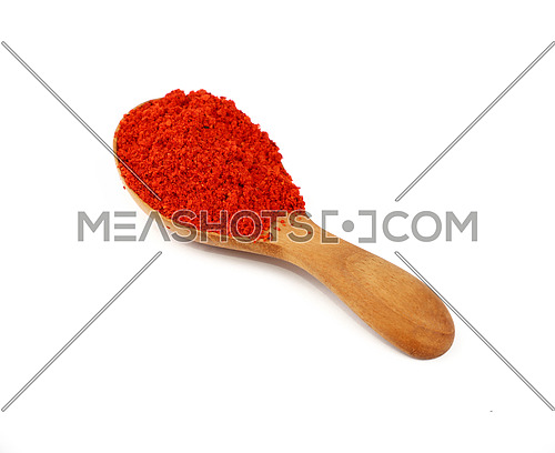 Close up one wooden scoop spoon full of red chili pepper or paprika powder isolated on white background, high angle view