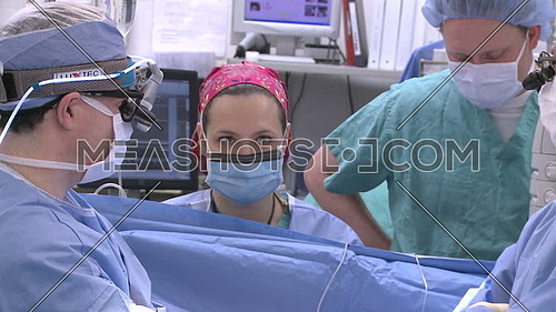 Medium shot for surgical team talking during surgery
