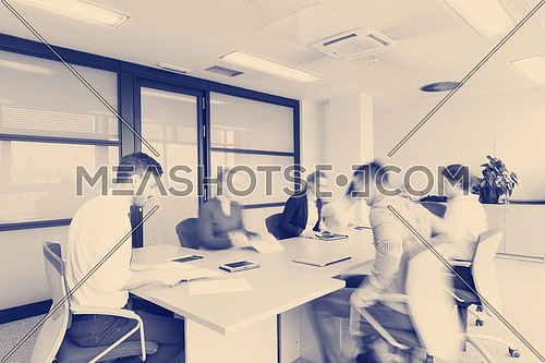 startup business  young creative  people group entering meeting room with motion blur  modern office interior