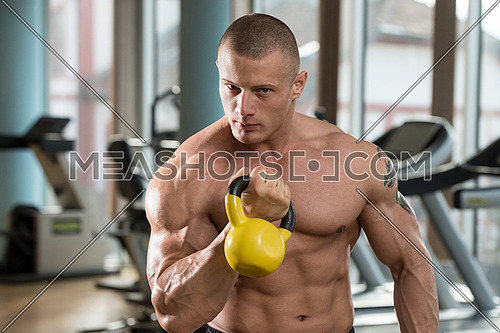 Athletic Man Workout With Kettle Bell