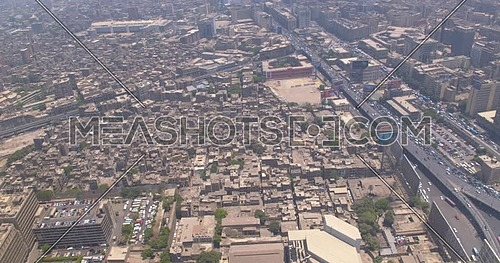 Reveal shot Drone for Cairo City showing Traffic and Bridges in Cairo Downtown at Day