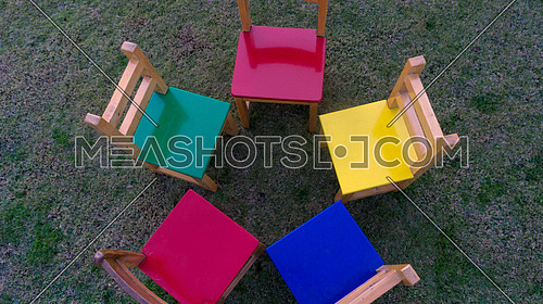 5 Colored chairs are placed in a circle