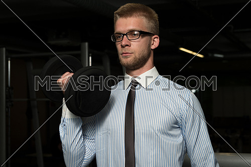 Businessman Working Out Biceps - Dumbbell Concentration Curls