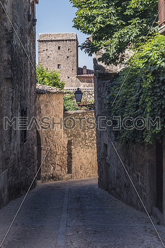 Typical narrow street of the old town of Caceres, Spain
