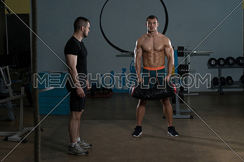 Handsome Guy Working Out Kettle Bell With Personal Trainer