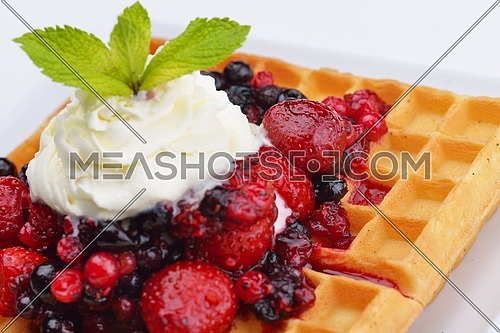a selection of three italian gelato ice-cream scoops topped with nuts, chocolate, fruit served on crispy waffels