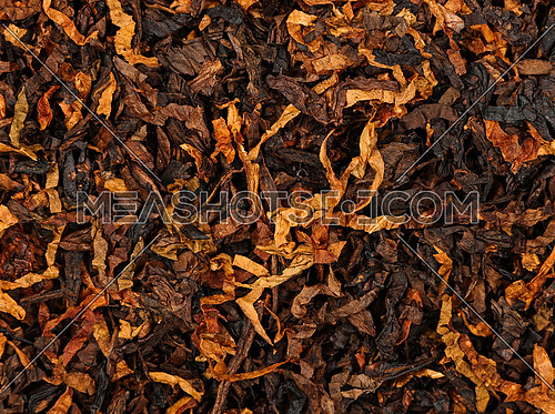 Close up background of ready rubbed long coarse cut pipe tobacco blend, elevated top view, directly above