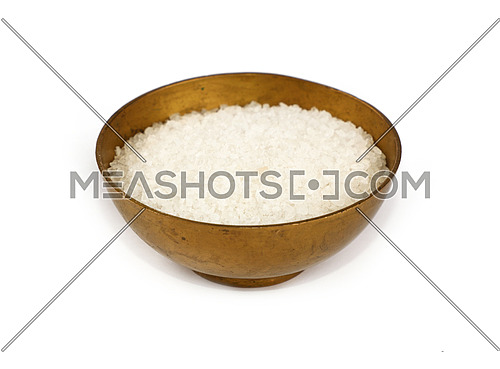 Close up one vintage bronze metal bowl full of white marine rock salt, isolated on white background, high angle view