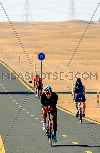 cyclist cycling on a track in the desert 6 February 2016 in Al Qudra Track in Dubai