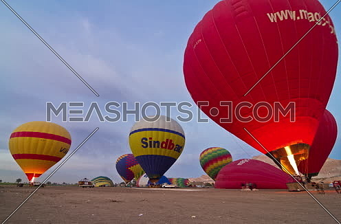 Fixed shot for Hot Air Ballons prepare to fly in Luxor