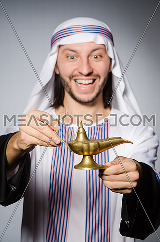 Arab with lamp in studio