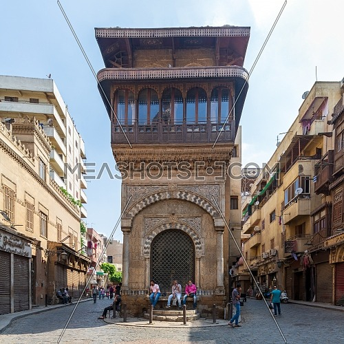 Cairo, Egypt- June 26 2020: Moez Street with few local visitors and Sabil-Kuttab of Katkhuda historic building during Covid-19 lockdown period, Gamalia district, Old Cairo