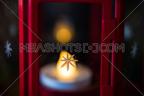 Candle Light with Christmas Star on its Glass