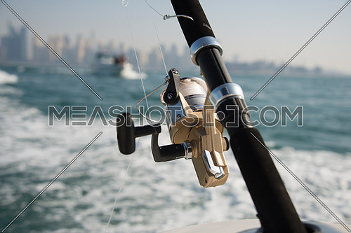 fishing rods or a boat in dubai UAE
