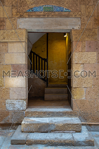 Ancient external old decorated bricks stone wall and doorway leading to the House of Egyptian Architecture historical building, Cairo, Egypt