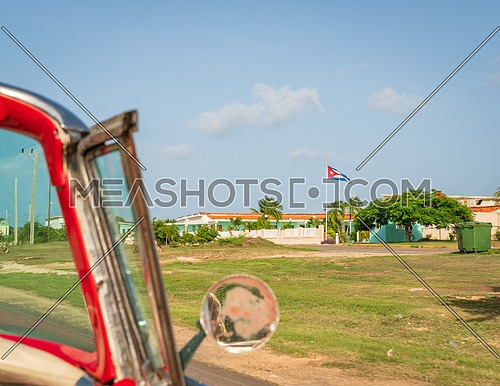 Cuba Varadero, view inside an old vintage classic american car on the right Cuban flag,sunny day.