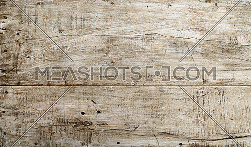 Grunge background texture of white painted wood with dark brown and black dirty stains, scratches and cracks