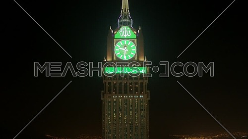 Fly down showing Royal Clock Tower in Mecca City at night.