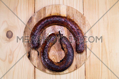 Fried Sausages On a Wooden Board