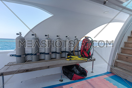 Long shot scuba tools on yacht by day.