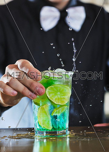 pro barman prepare coctail drink and representing nightlife and party event  concept