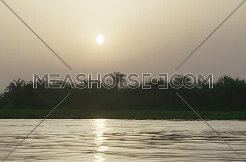 Follow shot on river nile at sunset