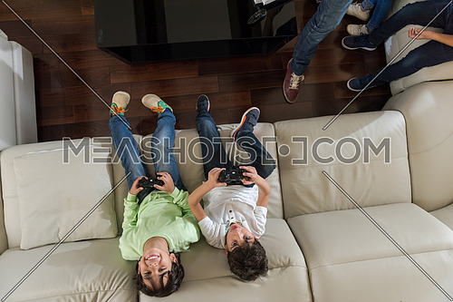 middle eastern children happily play video games and enjoy it with a smile on his face