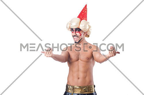 Ripped magician isolated on white